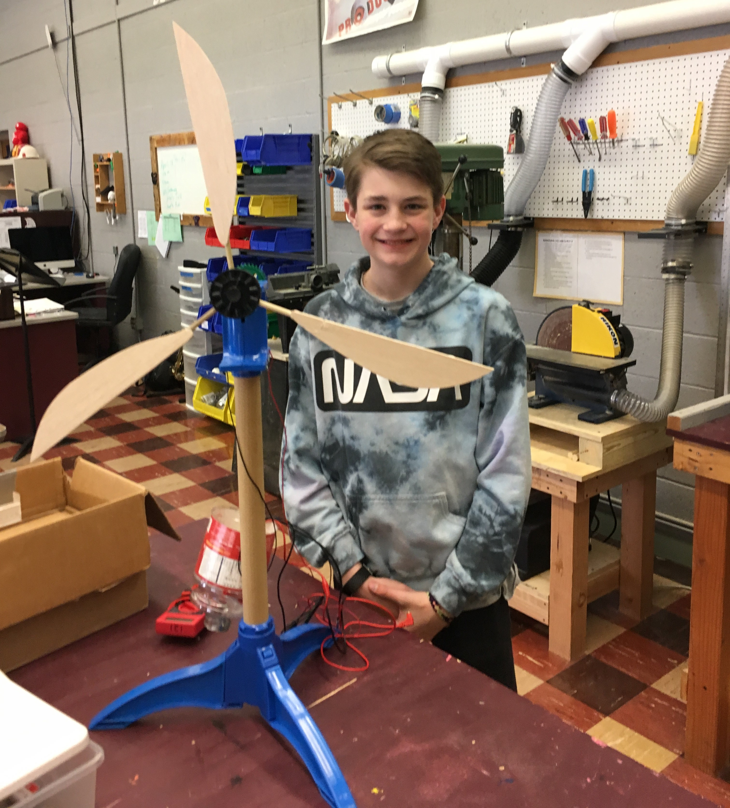 Cam Jeffrey with wind turbine designed for kidwind challenge