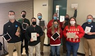 math teachers holding brand new iPads