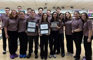 BOYS AND GIRLS BOWLING TEAMS HOLDING UP AAC AWARDS ON THE LANES