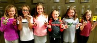 students holding popsicle ornaments to be sent to soldiers overseas