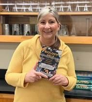 Boardman Bio teacher Heather Moran holding her book