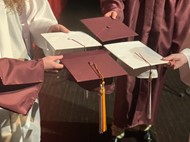 mortar board caps with 2020 tassels in maroon and white