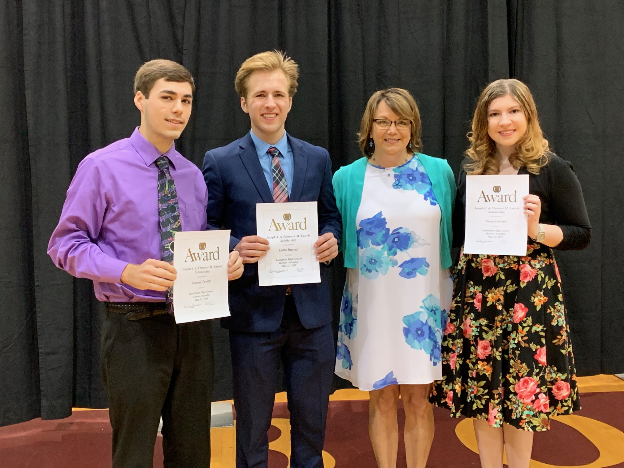 Scholarship winners Danny Turillo, Colin Russell, and Siena Larrick with Principal Fernback