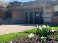 MARKET STREET ELEMENTARY ENTRANCE WITH FLOWERS BLOOMING