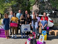 students, and administrators accepting school supplies from Boardman Subaru