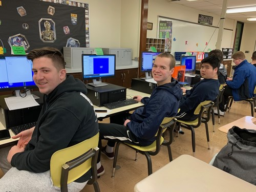 STUDENTS AT COMPUTERS FOR VIDEO GAME PROGRAMMING CLASS