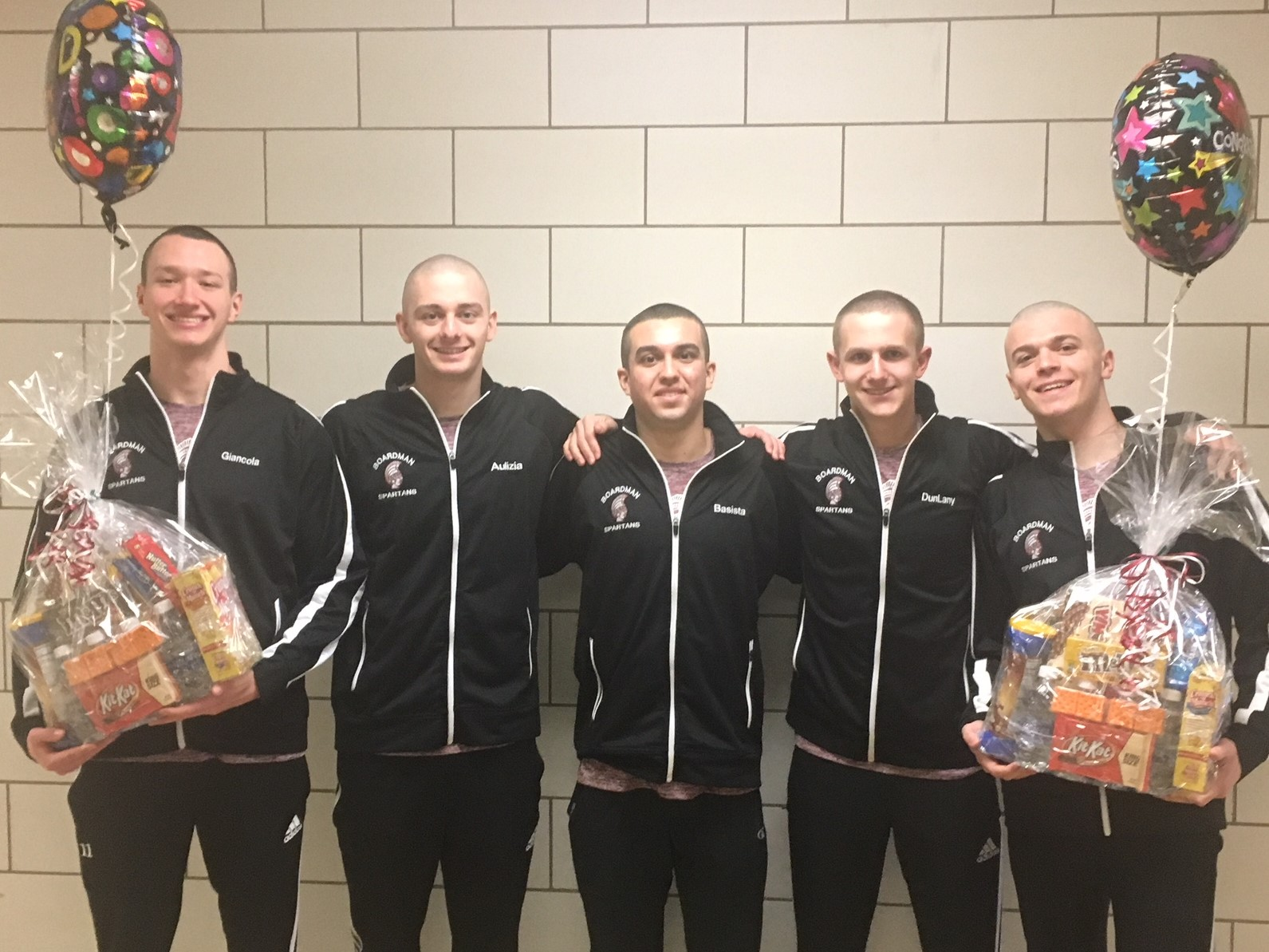 Swimmers headed to State Championships with gift baskets and balloons