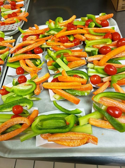 carrots, peppers and tomatoes on a tray