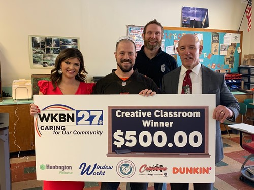 WKBN creative classroom award winner mr. diefenderfer  with $500 big check
