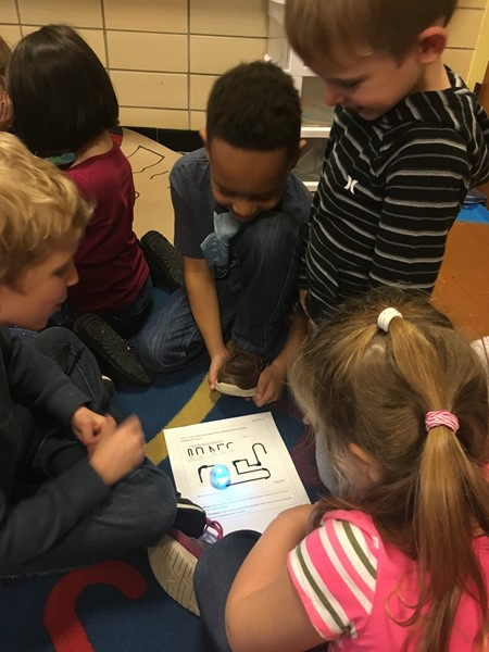 Students watch with amazement as the Ozobot zigzags across their page.