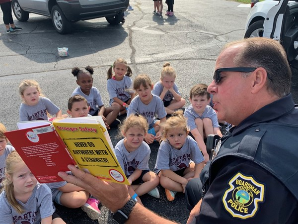 Officer reads to kindergarteners Never Go With A Stranger