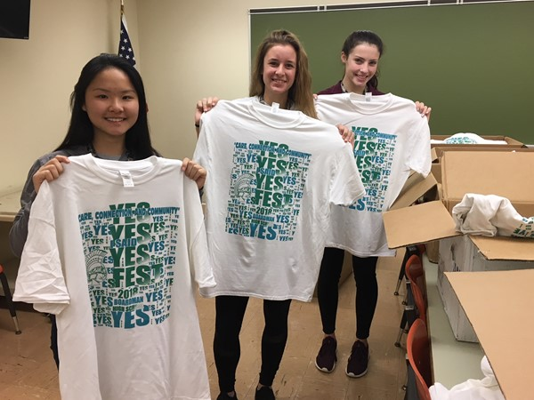 3 students showing off YES Fest 2018 shirts are green