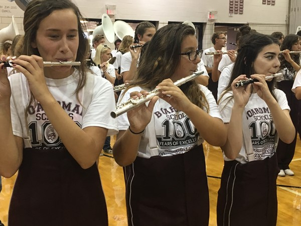 flutes playing as marching band fired up pep rally crowd