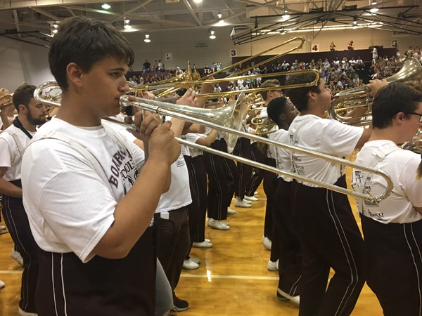 Trombone players as part of the pep rally performance