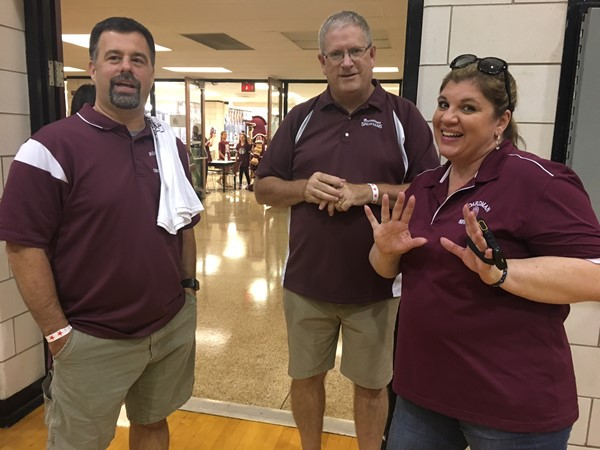 "Mr. Amendol, Mr. Calhoun, and Ms. Bott celebrating ""100"""
