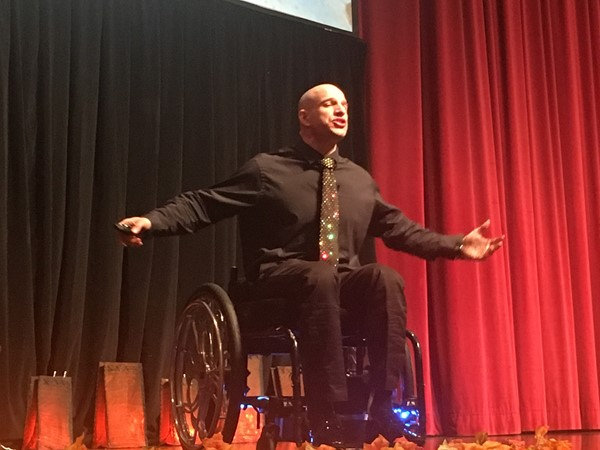 Wheelchair body builder and dance champion Nick Scott speaking to students