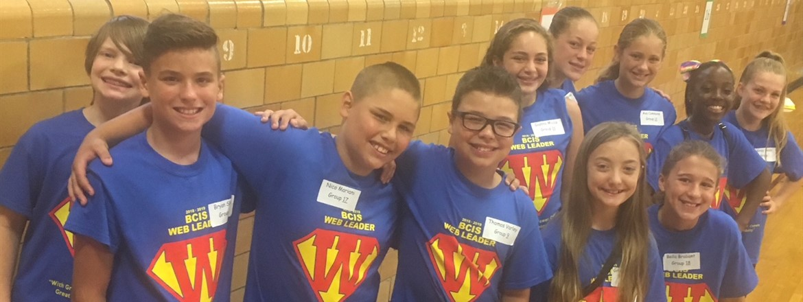 6th grade students wearing WEB superhero shirts. WEB stands for where everyone belongs