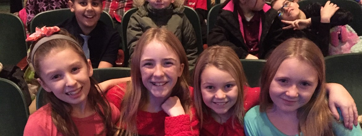 Students seated at Powers before the Miracle on Easy Street Show