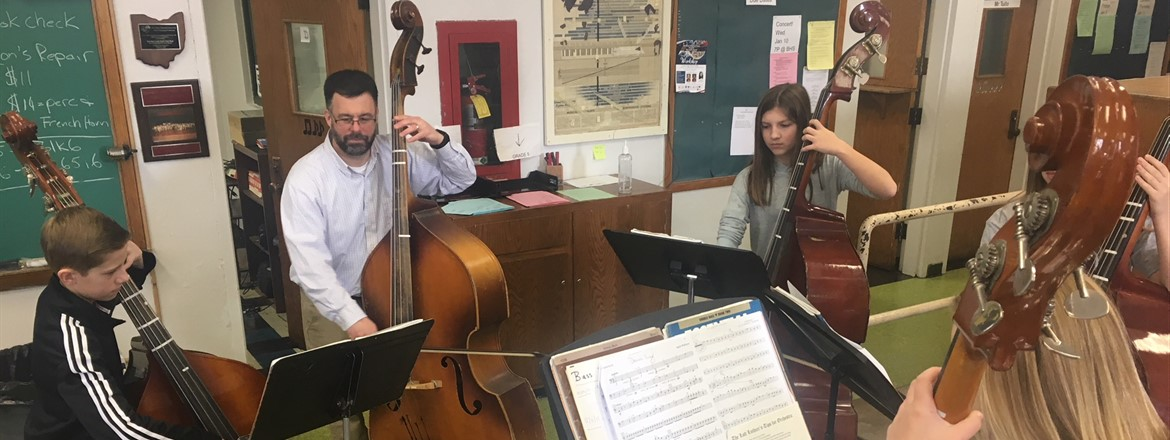 Mr. Amendol leads practice on base violin