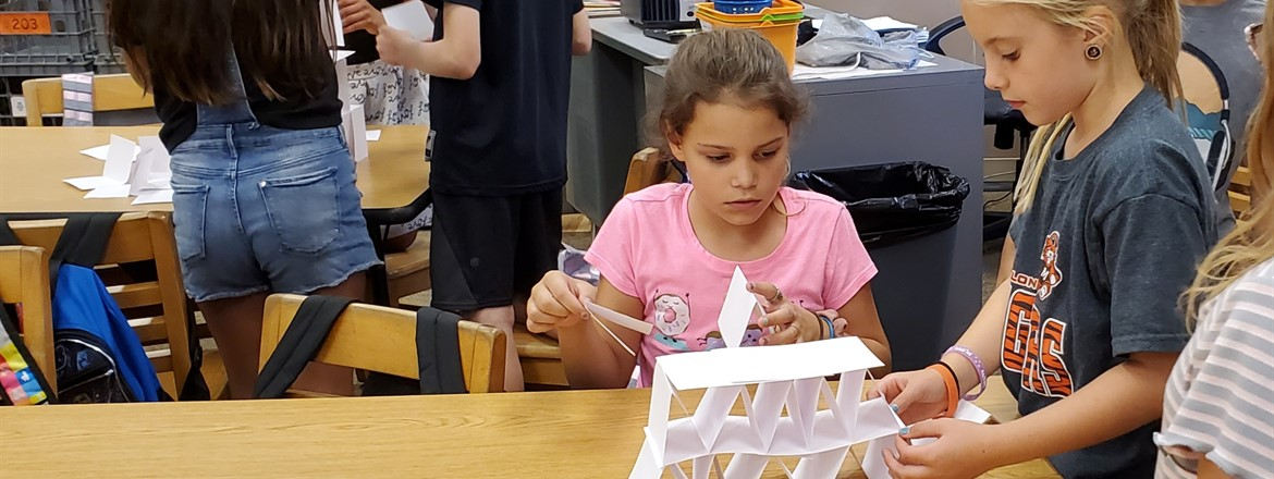 building a tower with a stack of index cards