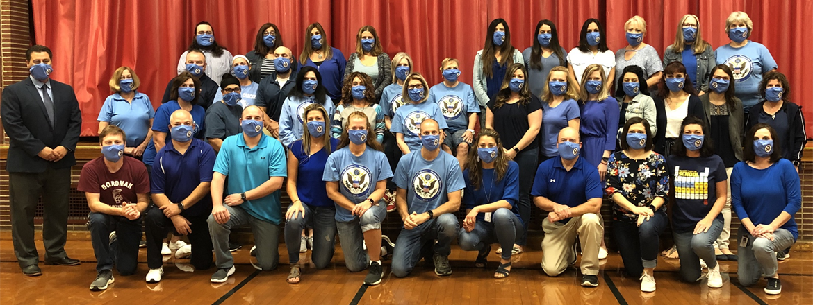 Wes Blvd. staff dressed in blue with blue ribbon face masks