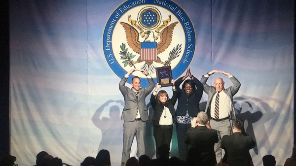 Accepting Blue Ribbon Schools Award with an O-H-I-O