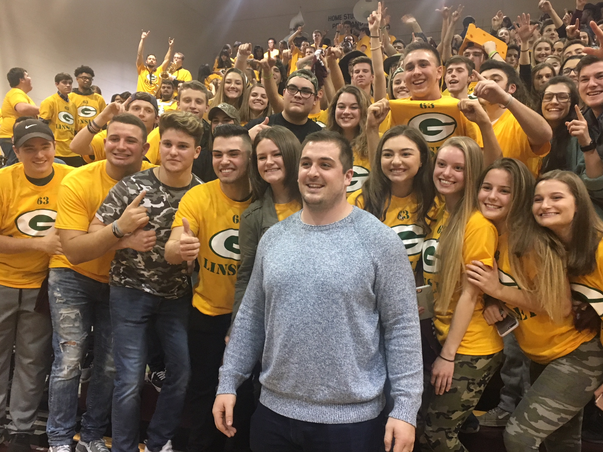 corey with students dressed in packer gear