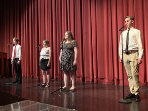 seniors Sarah and Sydney Moon, Wil Arnim, and Chase Pacino sing Time For Movin' On