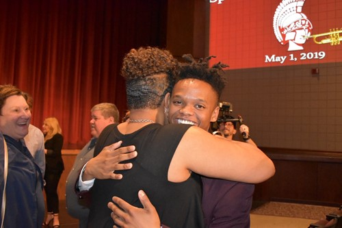 Miles hugs his mom, after winning the 25K scholarship
