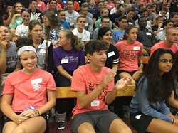 freshmen and link crew leaders in the stands in the gym
