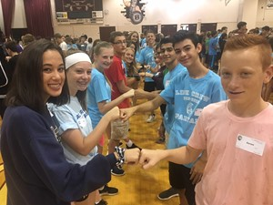 Link crew leaders fist bump incoming freshmen partners at orientation