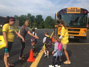children practicing getting on school bus during safety village