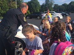 police passing out coloring books