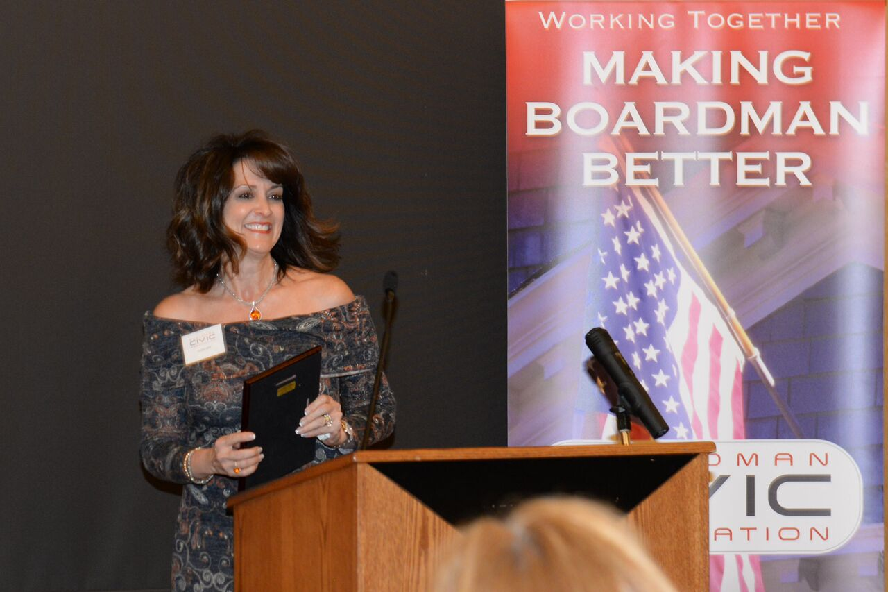 Karen Veri accepts Community Service Award