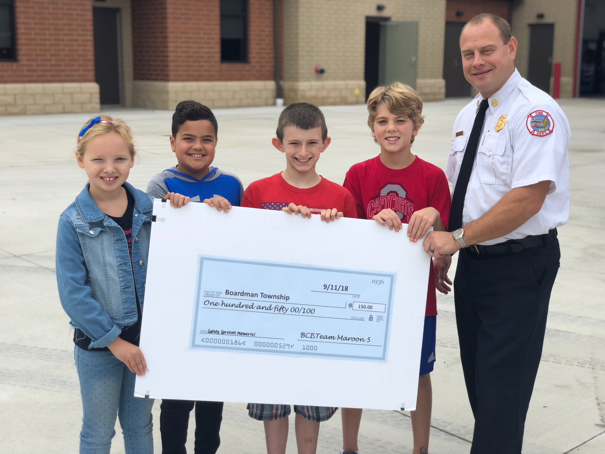 students present check to Chief Pitzer
