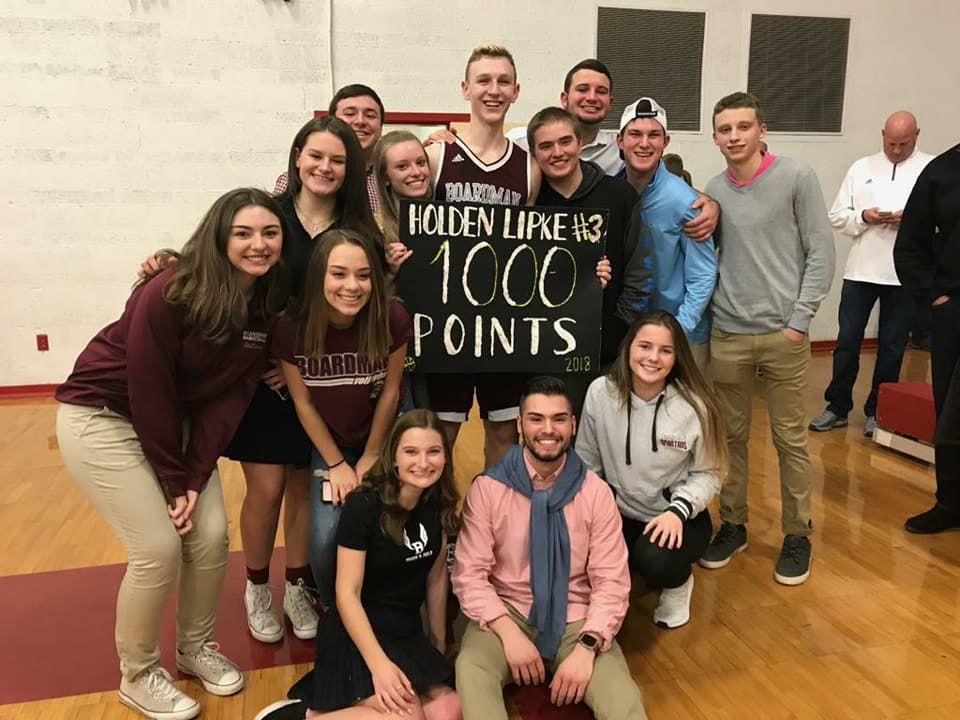 Holden Lipke surrounded by fans after making 1000 point milestone