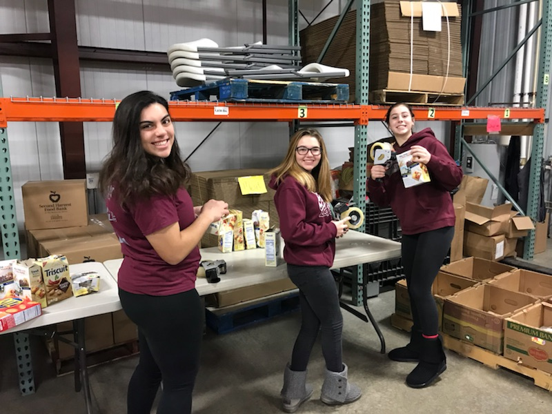 Students sorting and examining food at Second Harvest Food Bank