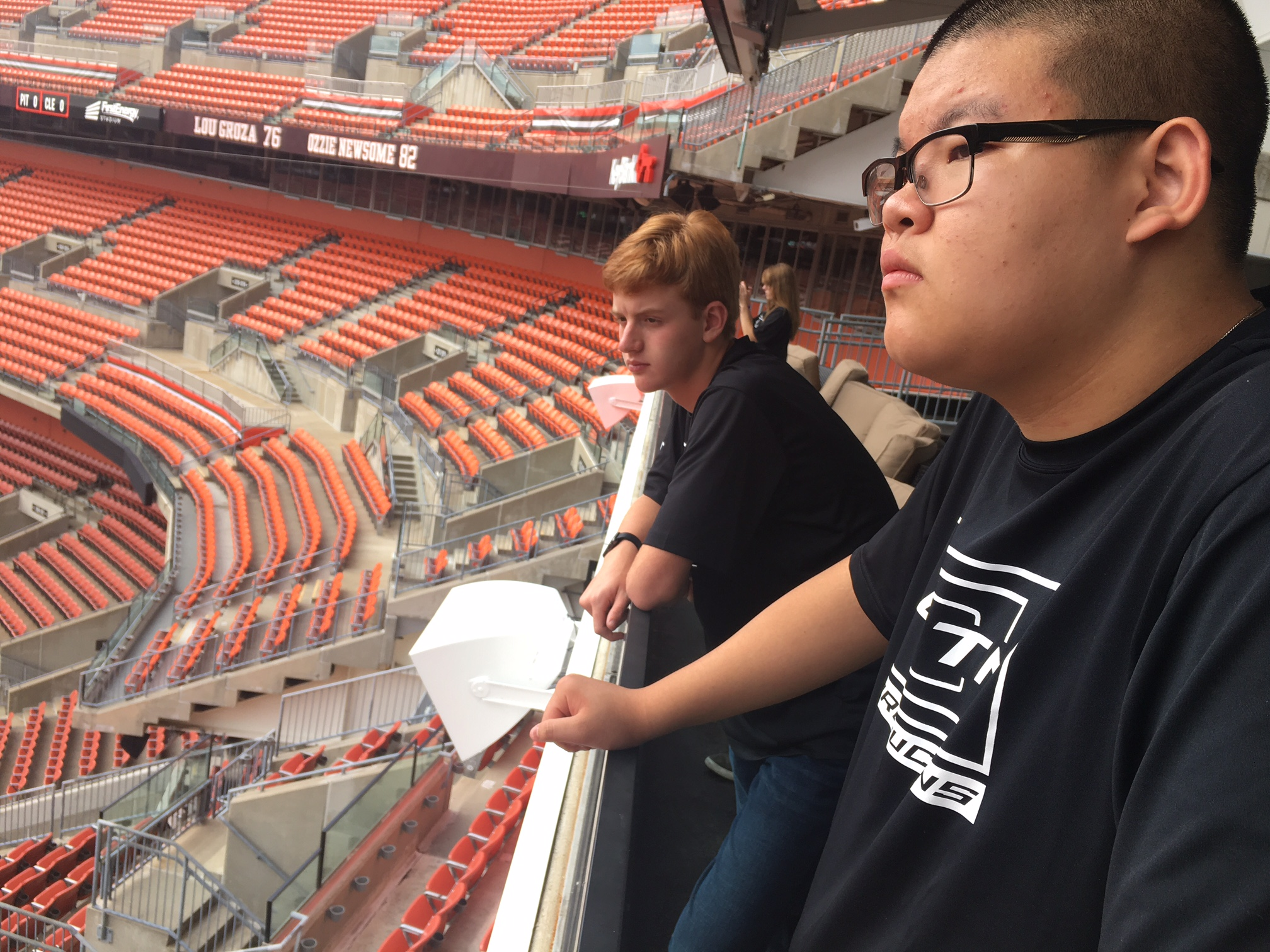 students looking at field from stadium seats