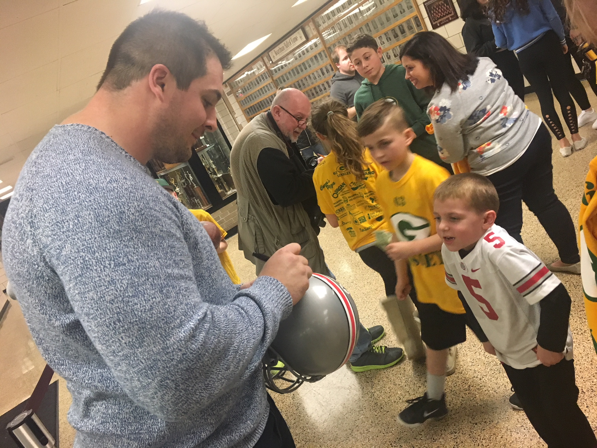 Corey signs helmet for elementary student