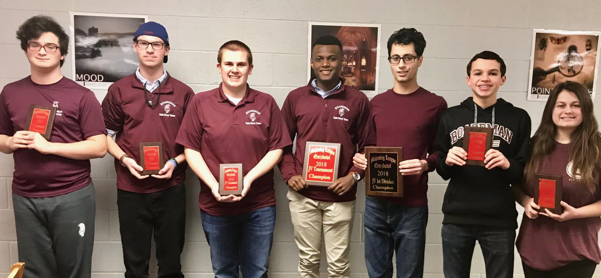 Quiz Bowl JV team with plaques